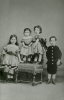 Unknown artist (19th century): Photograph of Alfred A. De Pass as a child with his three sisters, photograph, 15 x 10.5 cms. Presented by Catherine Wallace.