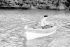 Penrose, Sir Roland (1900-1984): Man Ray in a boat, Lambe Creek, photograph, 29.5 x 39.1 cms. Purchased with grant aid from the Esmee Fairbairn Foundation in 2004. © Roland Penrose Estate. All rights reserved.