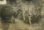 Unknown artist (early 20th century): Henry Scott Tuke painting Howard Fox at Rosehill gardens, photograph, 21 x 29.5 cms.