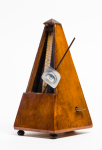 Unknown artist: Reconstruction of Man Ray's metronome, dated 2004, metronome, 22 cms high.